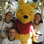 Amber and her family meeting with Winnie the Pooh