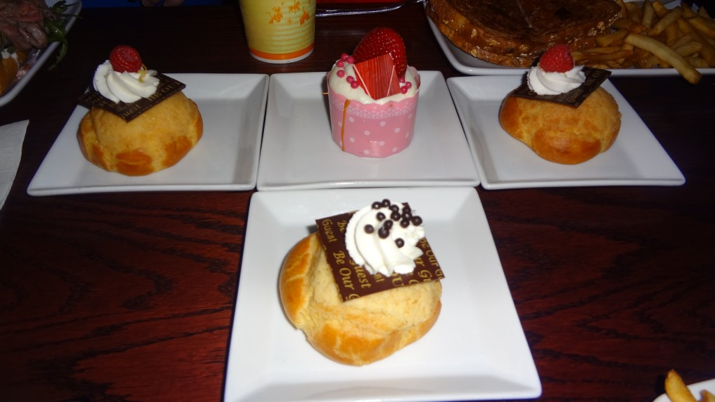 Delicious dessert options available - profiteroles and cupcakes!