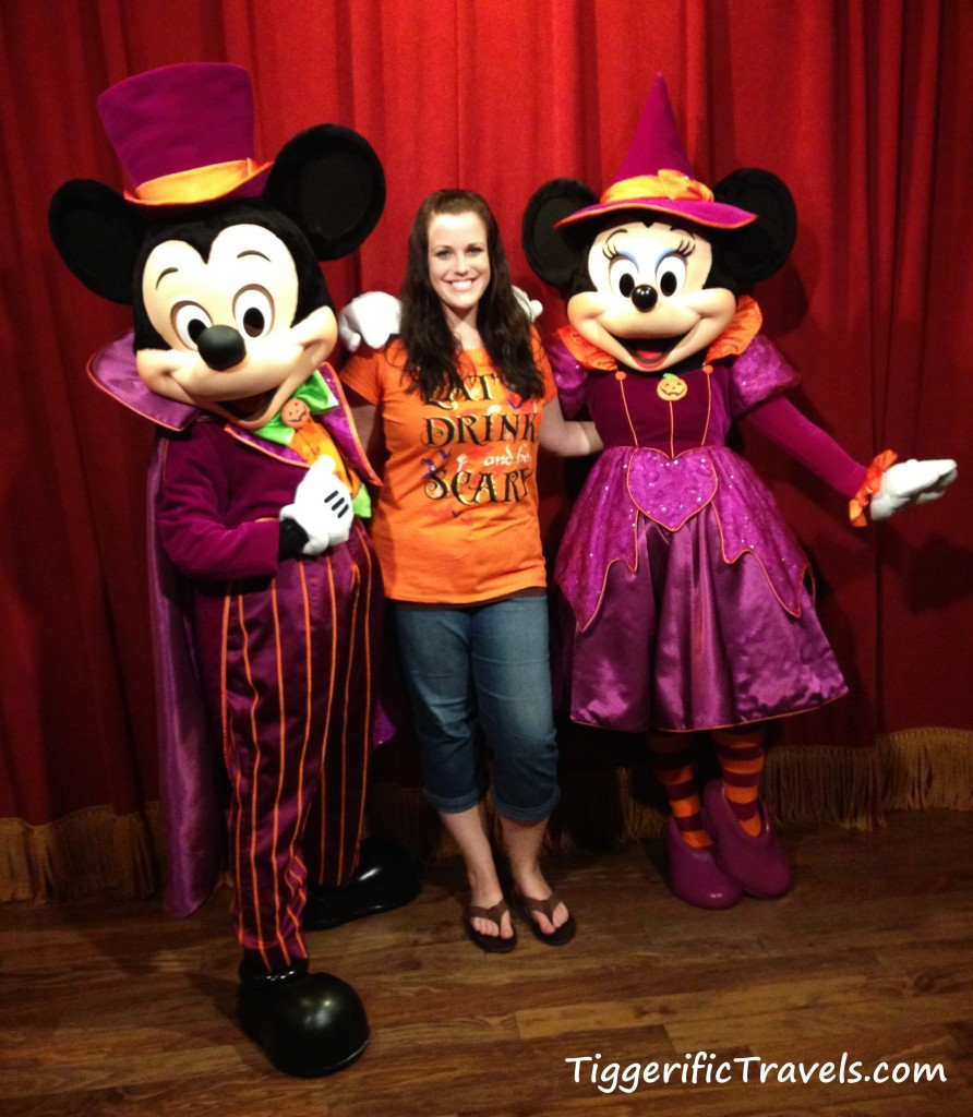 Tiggerific Travels Agent Marisha poses with Mickey and Minnie in their Halloween Costumes
