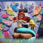 Ariel greets guests as they enter the Little Mermaid building at the Art of Animation
